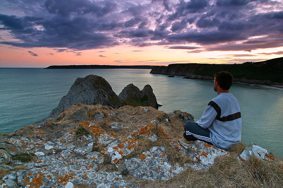 Contemplating the sunset over Three Cliffs Bay, Gower