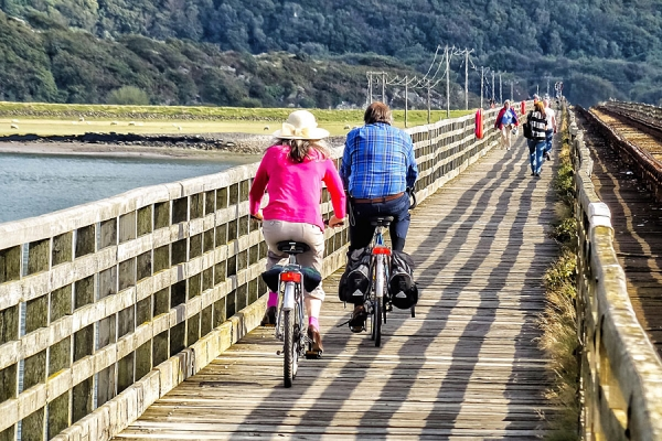 Cycling over Barmouth Bridge on the Wales Coast Path