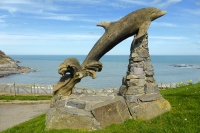 Leaping dolphin sculpture at Aberporth, on the Wales Coast Path