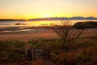 Sunrise over Snowdonia, seen from Llanddwyn Island, on Anglesey